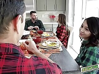 The teens decide to pleasure each others dads They crawl under the table and stick their thick turkey basters in their mouths