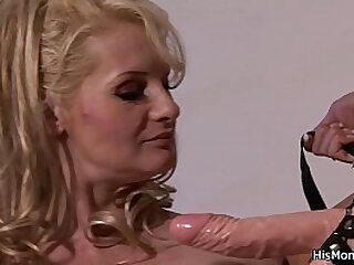 His busty blonde mommy riding huge strapon