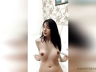 Pretty Asian college girl demonstrates her fake boobs for money